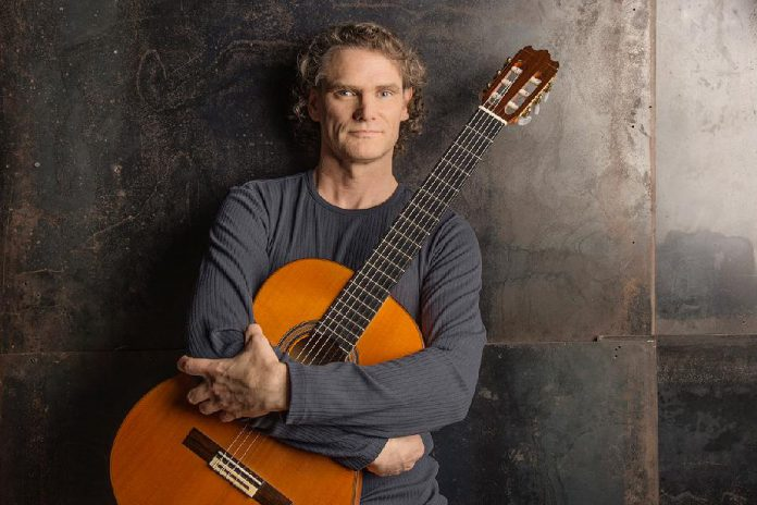 "Guitar virtuoso Jesse Cook, best known for his ""nuevo flamenco"" compositions, performs at Peterborough Musicfest at Del Crary Park on Wednesday, July 5th. (Photo: Allen Clark)"