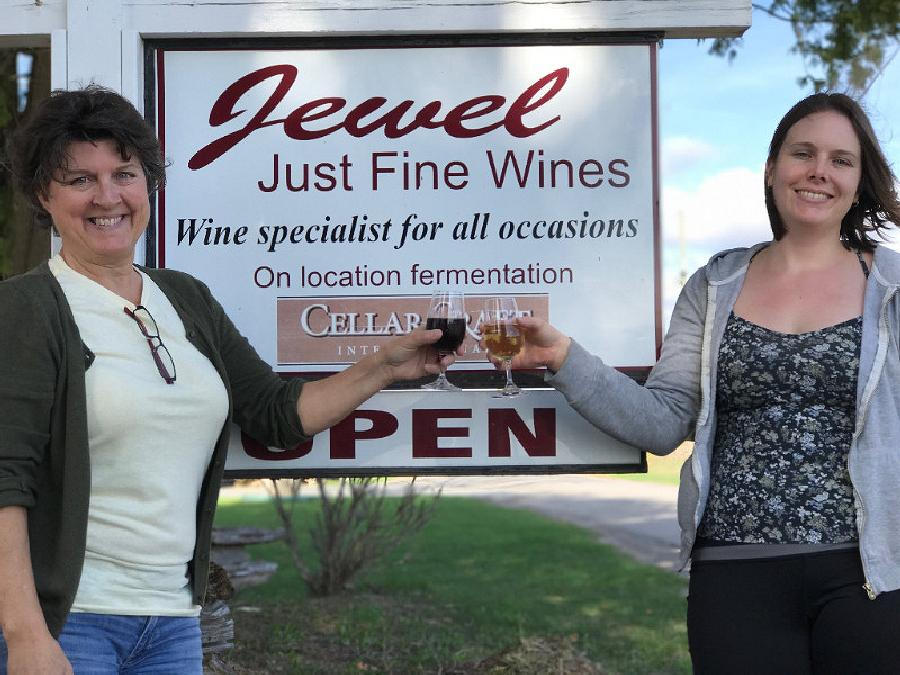 Rachel Bleakley (right) and former owner Jordon Hale toast to a new future at Jewel Just Fine Wines. (Photo: Jewel Just Fine Wines)