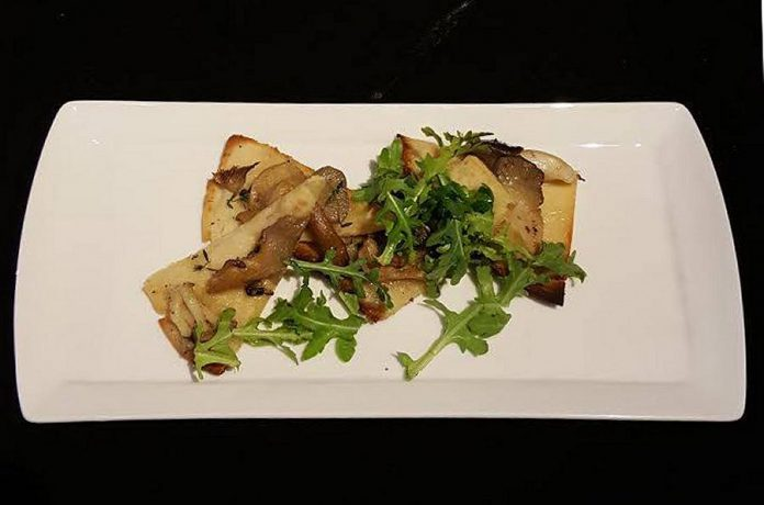 Flatbreads have become a popular pick on the  Hunter County Cuisine and Wine Bar menu. This one is made with mushrooms from Waymac Farms. (Photo: Kyle Wagenblast)