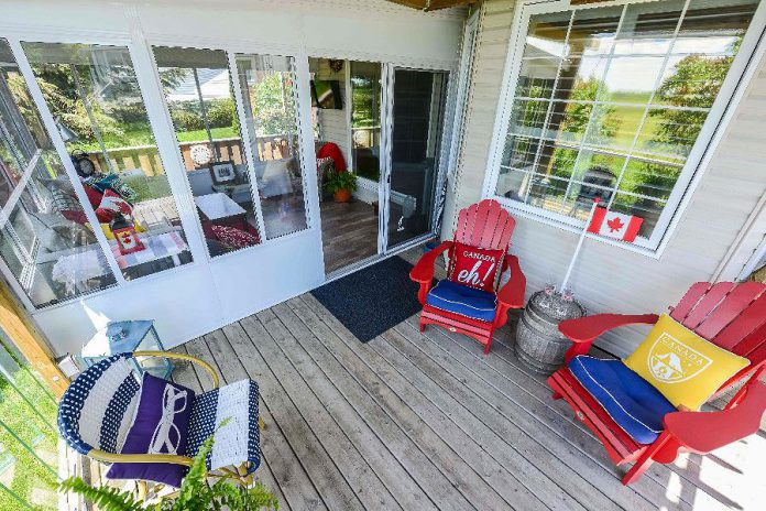 The Hogan's Lifestyle Home Products glass-walled sunroom is located directly off their back deck, which came in handy last year when rain fell during their Canada Day party. (Photo: Lifestyle Home Products)