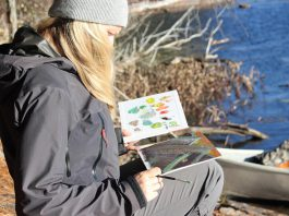 A participant in a plein air painting and paddling workshop held earlier this April. You'll be wearing summer clothes for one of the four experiences during July, August, and September offered by The Canadian Canoe Museum and The Land Canadian Adventures. (Photo courtesy of The Canadian Canoe Museum / The Land Canadian Adventures)