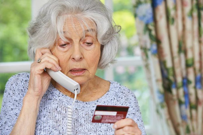 Elderly woman responding to phone scam