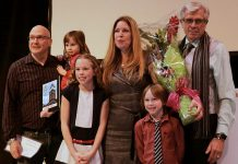 Tina Bromley (centre) her family after winning the Peterborough DBIA's Win This Space contest in February 2017. CBC Ontario Morning will interview Bromely after the Town of Dryden recently launched its own Win This Space competition. (Photo: Peterborough DBIA)