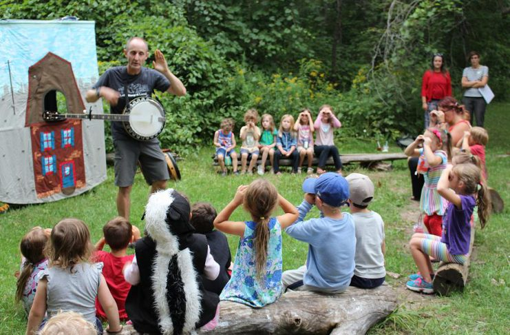 Children enjoy a performance from The Paddling Puppeteer at last year's GreenUP Ecology Park Family Night. This year, join GreenUP for a 25th Birthday Celebration and Family Night on Thursday, August 24th at Ecology Park at 1899 Ashburnham Drive in Peterborough for stream study, music, nature crafts, lantern walk, bike decorating, birthday cake, and more. (Photo: GreenUP)