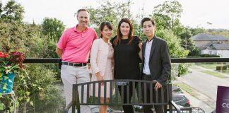 The memorial bench for the late Dr. Judith Buys at Cornerstone Family Dentistry. Pictured are Judith's husband Dr. James McGorman, Cornerstone co-owner Dr. Anna Jo, Cornerstone office manager Amanda Crowley, and Cornerstone co-owner Dr. Jay Chun. (Photo by Tracey Allison of Tracey Allison Photography, a former Cornerstone employee.)