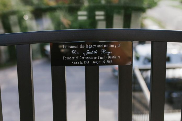 The plaque on the memorial bench honouring Cornerstone Family Dentistry founder Dr. Judith Buys, who died tragically on August 16, 2016 at the age of 55, leaving behind her husband and two sons. (Photo: Tracey Allison, Tracey Allison Photography)