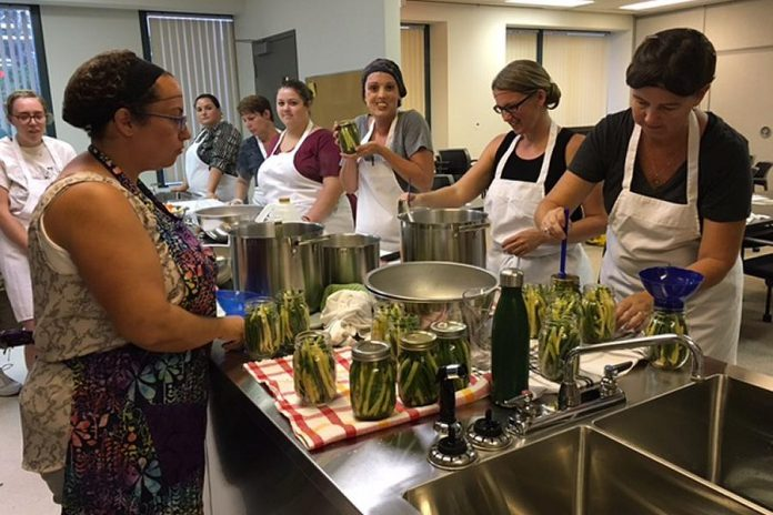 Nourish's canning workshops offer an opportunity for members of the community to learn to can in a fun, collaborative environment. (Photo: Nourish Project)