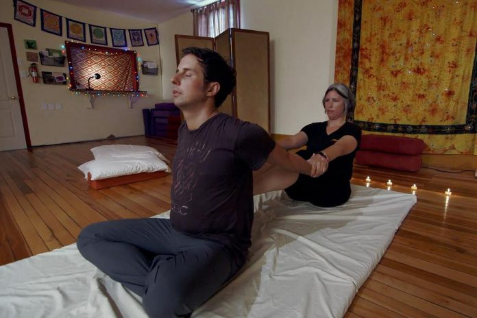 Jonny Harris, host of the CBC Television series Still Standing, receives a Thai massage from Caroline Owen of Wavelengths Yoga Studio in Norwood. The episode will be broadcast on August 22, 2017 and then will be available to view online. (Photo: CBC Television)