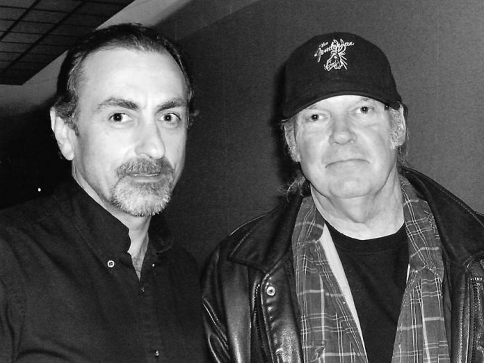 Youngtown Museum founder Trevor Hosier with Neil Young back stage at the Air Canada Centre in Toronto in 2008. The Youngtown exhibit at the Olde Gaol Museum in Lindsay is closing for good on September 10, 2017, and Hosier will be selling some of the items from his collection. (Photo: Stephen Hosier)