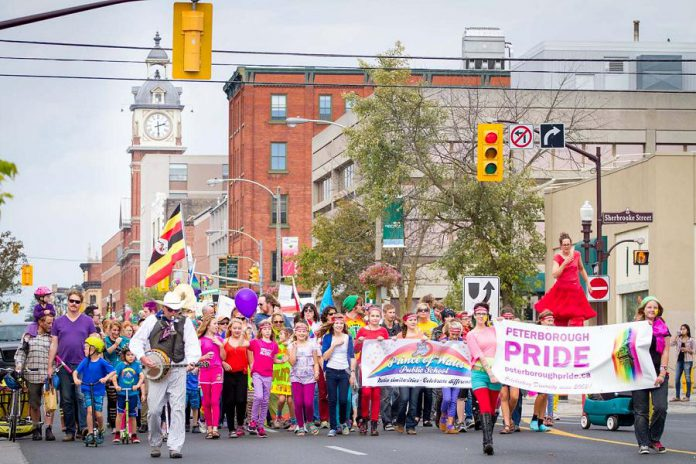 """The 2014 Peterborough Pride parade making its way down George Street in downtown Peterborough. This year's Pride Parade takes place at 1:30 p.m. on Saturday, September 23 followed by """"Pride in the Park"""", a family-friendly celebration that runs until 6 p.m. in Millennium Park. (Photo: Roberto Bonifacio)"""