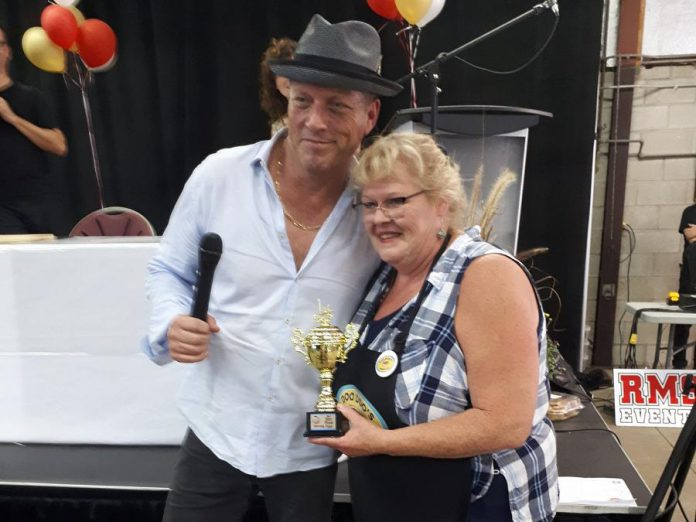 Food Network Canada chef David Adjey presents Diane Rogers of Doo Doo's Bakery in Bailieboro with her first place trophy for the Best Plain Butter Tart. (Photo: Butter Tart Tour)