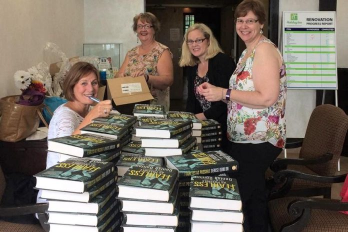 "WBN Board Members Diane Wolf, Shelley Barker, and Karen Copson with Denise Donlon. Each WBN member at the September 6th meeting received a signed copy of Donlon's 2016 memoir ""Fearless as Possible (Under the Circumstances)"". (Photo: Denise Donlon / Instagram)"