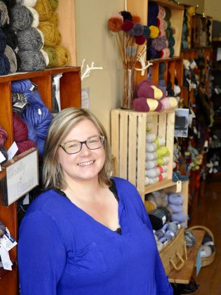 Deanna Guttman, owner and operator of Needles in the Hay on Water Street in downtown Peterborough, is celebrating her first anniversary of ownership by expanding her yarn shop to include the coveted Brooklyn Tweed woolen yarn line. (Photo: Jeanne Pengelly / kawarthaNOW)