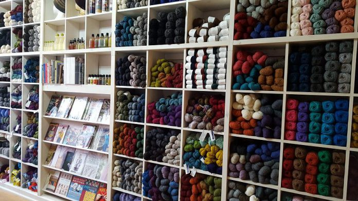 """The """"wall of yarn"""" at the newly renovated Needles in the Hay in downtown Peterborough. Owner Deanna Guttman is offering five wools from Brookyn Tweed in various weights and colours: 20 colours of Shelter, Loft, and Arbor, and seven colours in the Quarry and Vale lines. (Photo: Deanna Guttman)"""