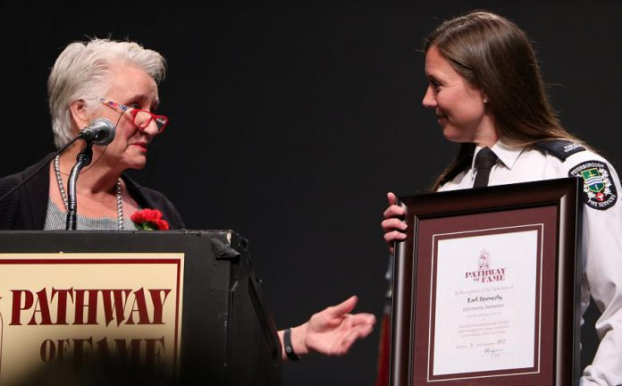 Margaret Spencley-Miller accepts the Pathway of Fame honour from Peterborough Fire Services for her late father Earl Spencely, a florist who lost his life as a volunteer firefighter battling a blaze at the Zack's Building in downtown Peterborough in 1951. (Photo: Sean Bruce, Freelance Photographer)
