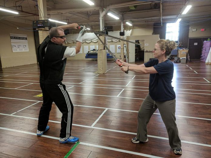 Peterborough Multi-Sport Club owners and coaches Scott Nichols and Michelle Curran enjoy a friendly spar with longswords. All of the techniques used at the club's practices are based on historical European martial arts and is supported by strength, speed and assertive execution. (Photo: Peterborough Multi-Sport Club)