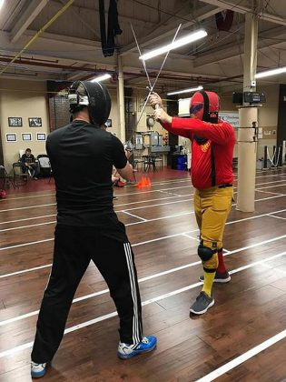 Head Coach Scott Nichols, left, and Ottawa swordplay instructor Craig Shackleton, right, give a longsword demonstration. German longsword fighting has become a revival of a once-forgotten ancient European martial art with timed bouts and complex rules. (Photo: Peterborough Multi-Sport Club)