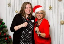 Susan Dunkley (right) is a long-time member of the Women's Business Network of Peterborough and often called upon to lead (and emcee) the organization's fundraising events. Here she is with WBN member and co-emcee Meghan Moloney at the network's Christmas Gala, an annual event that raises funds for YWCA Crossroads Shelter. (Photo: WBN)