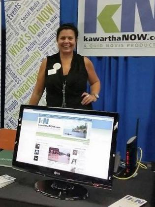 Jeannine Taylor promoting kawarthaNOW.com at a Peterborough Chamber of Commerce trade show in 2013.