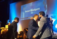 Peter Blodgett of Darling Insurance hugs his son Jeff after being named Business Citizen of The Year at the 2017 Peterborough Chamber Business Excellence Awards at Showplace Performance Centre on October 18. (Photo: Jeannine Taylor / kawarthaNOW.com)