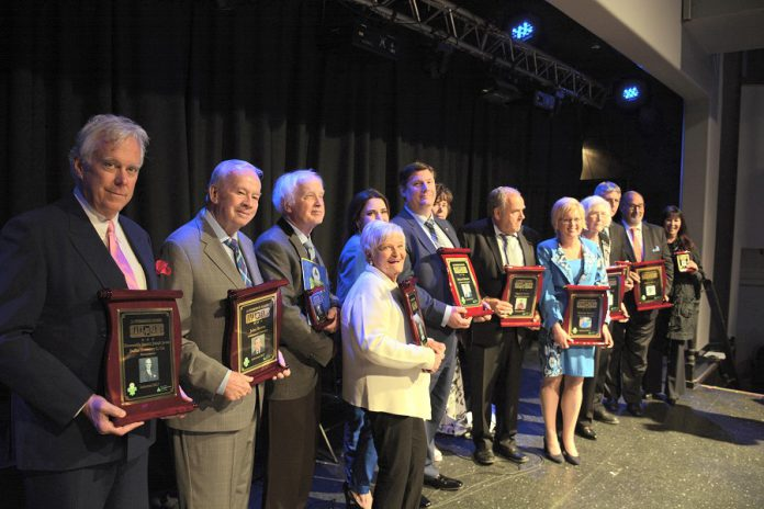Nominations for the 2018 Peterborough Business Hall of Fame are open until November 30, 2017. Pictured are the 2017 Hall of Fame inductees and their representatives at this year's induction ceremony: Peter Duffus, John Bowes, Elwood Jones, Mary McGee, Catia and Mike Skinner, Susan and Darrell Drain, Rhonda Barnet, Eleanor and Carl Young, and Shelley and David Black. (Photo: Eva Fisher / kawarthaNOW.com)