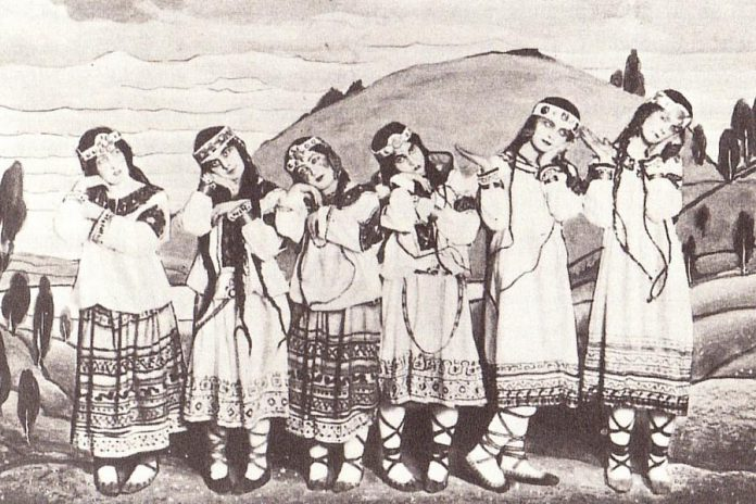 "Dancers from the original production of ""The Rite of Spring"" posing in costumes by Russian painter and archaeologist Nicholas Roerich, who based the costume designs on Russian peasant folklore and early pagan customs. (Public domain photo)"