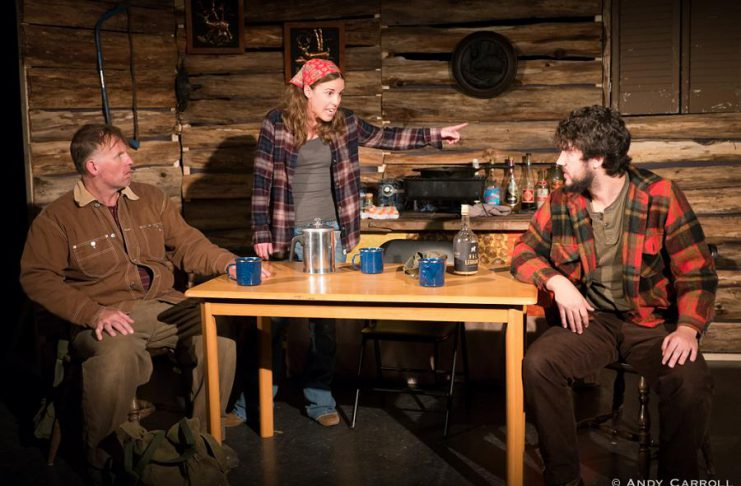 """Nathan Govier as Wayne, Lindsay Unterlander as Becky, and Kelsey Gordon Powell as Roger in Planet 12 Productions' """"Incident On Gun Mountain"""", about a trio of deer hunters in the early 1970s who endure a descent into guilt, paranoia, terror, and the fantastic. (Photo: Andy Carroll)"""