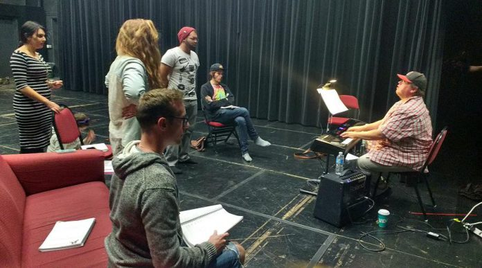 """Justin Hiscox rehearsing with the cast of Amber Coast Theatrical's """"Fugitive Songs"""", one of four upcoming shows Justin is currently working on. (Photo: Sam Tweedle / kawarthaNOW.com)"""