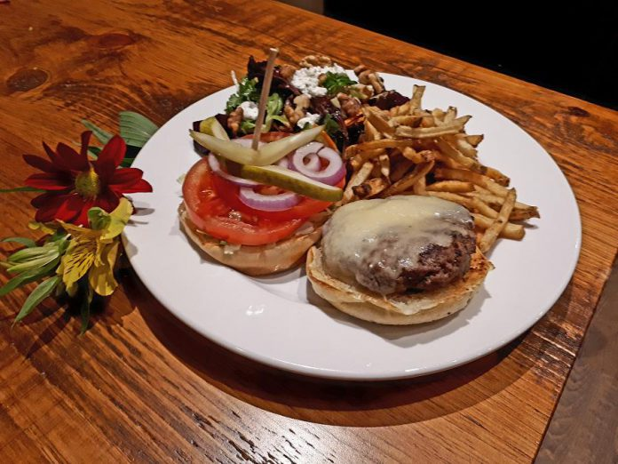 Moody's homemade hamburger with aged cheddar, fries, and a roasted beet salad. Some of the ingredients come from Circle Organic farm in Millbrook. (Photo: Moody's Bar and Grill)
