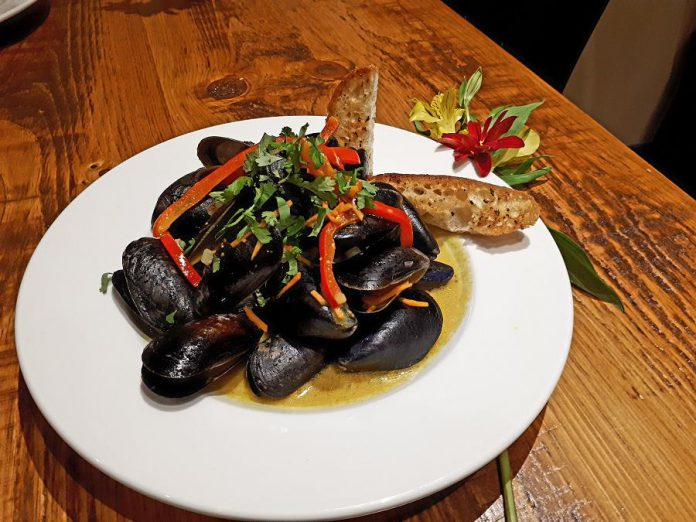 Moody's Thai Coconut and Peanut Mussels with cilantro and red bell pepper. (Photo: Moody's Bar and Grill)
