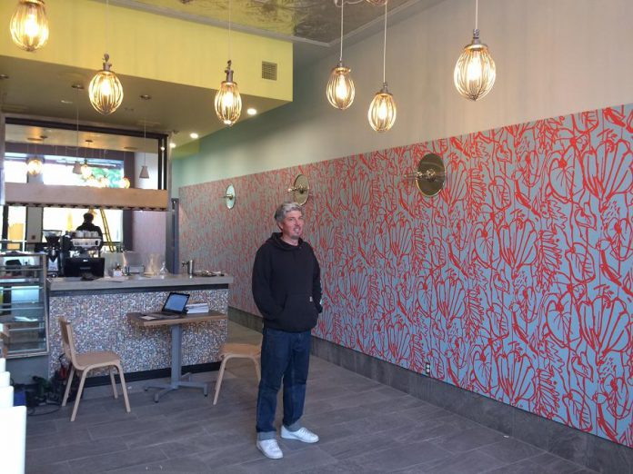 The Night Kitchen's new location is decorated with lights made by owner Tim Weatherup from mixer attachments. (Photo: Eva Fisher)