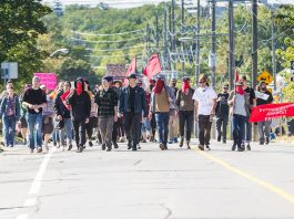While the vast majority of participants at the anti-hate rally in downtown Peterborough on September 30, 2017 were local residents who protested peacefully, some of the protestors disguised their identities and some came from outside the area, including 22-year-old William October of Toronto who has been charged with assault and obstruct peace officer. (Photo: Linda McIlwain / kawarthaNOW.com)