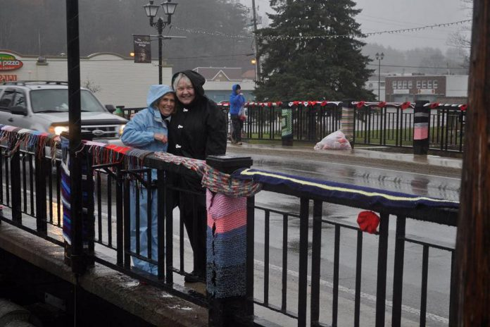 Volunteers installed the poppies on a cold and rainy November day, reminding them of the terrible conditions endured by Canadian soldiers in the trenches during World War I. (Photo: Hospice North Hastings / Facebook)