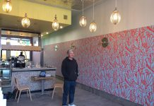 Gourmet pizza purveyor The Night Kitchen has reopened in its new location at 168 Hunter Street in downtown Peterborough. The interior is decorated with lights made by owner Tim Weatherup from mixer attachments. (Photo: Eva Fisher / kawarthaNOW.com)