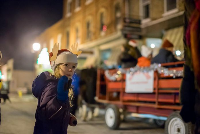 There are lots of activities for the entire family during Christmas in the Village, including horse-drawn wagon rides, a gingerbread house display, a juggler, crafts, and games. (Photo: Marjorie McDonald)