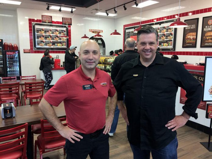 Area representative Alex Gerzon and franchisee Jason Taylor of Firehouse Subs, a new chain restaurant to Peterborough that raises funds to benefit emergency personnel. (Photo: Eva Fisher / kawarthaNOW.com)