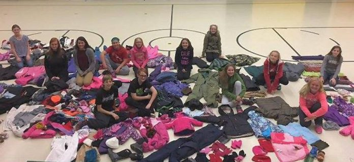 Students from St. John Catholic Elementary School in Peterborough with the coats they collected for the 2016 Northern First Nation Coat Drive. (Photo: Kawartha Truth and Reconciliation Support Group)