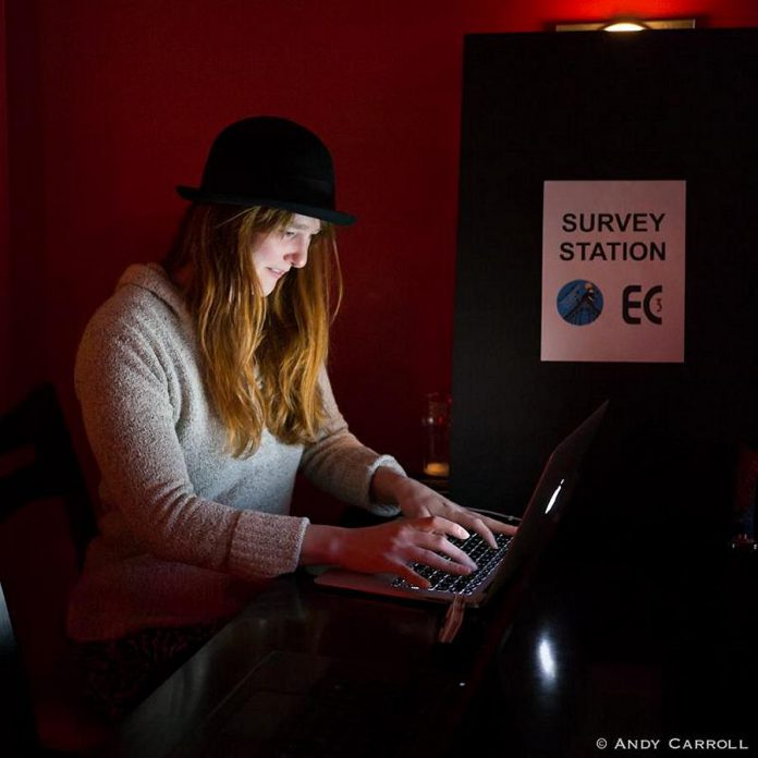 Naomi DuVall completes the Peterborough Artist Survey at a survey station located at the Sapphire Room during the Precarious Festival launch. Electric City Culture Council is collecting data from working artists living in Peterborough and the surrounding areas. (Photo: Andy Carroll)