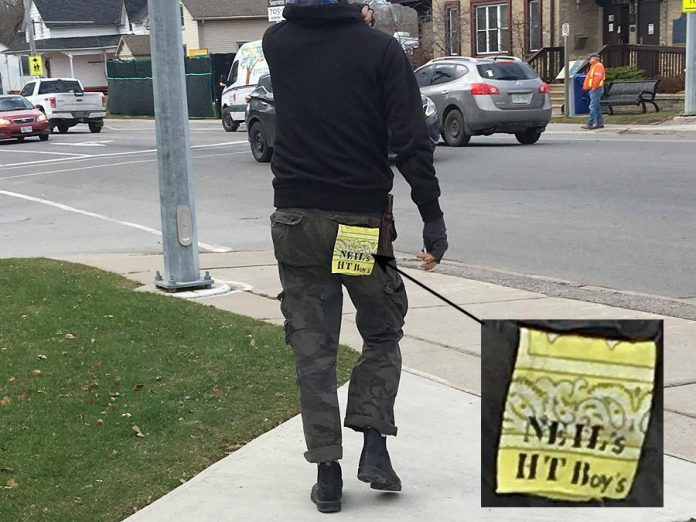 """In one of the worst-kept secrets of 2017, organizers of Neil Young's """"Home Town"""" concert refused to disclose the location, despite obvious evidence like this photo of a tag hanging from the back pocket of one of the crew unloading equipment into Coronation Hall in Omemee. (Photo: Craig Foster)"""
