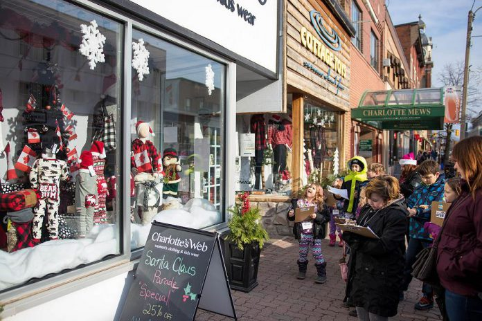 Children involved with Big Brothers Big Sisters of Peterborough judged holiday window displays at 22 stores  in downtown Peterborough on Saturday, December 2. (Photo: Peterborough DBIA)