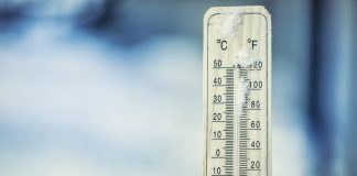 Thermometer on snow showing extreme cold temperature of 20 below zeroExtreme cold