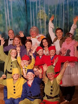 "Some of the cast in Globus Theatre's production ""Snow White and the Seven Dwarfs"". A traditional British panto is fun for the entire family, with an immersive and colourful tale for the children and a little bit of innuendo for the adults. (Photo: Sarah Quick)"