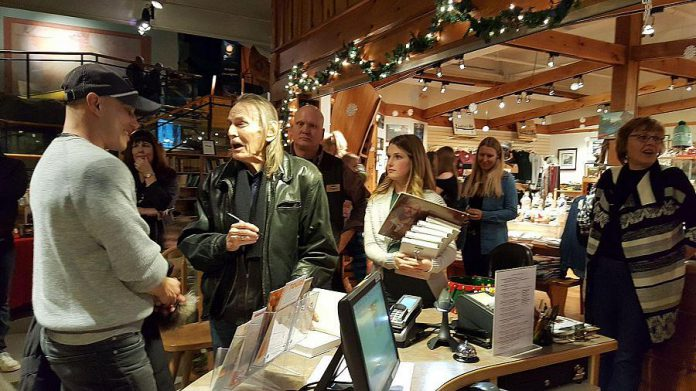 Lightfoot signing books in The Canadian Canoe Museum gift shop. (Photo: Jeannine Taylor / kawarthaNOW.com)