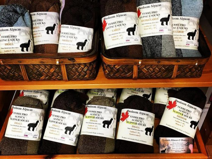 The GreenUP Store carries alpaca wool insoles, socks, mitts, and hats from Twoloom Alpacas. (Photo: GreenUP)