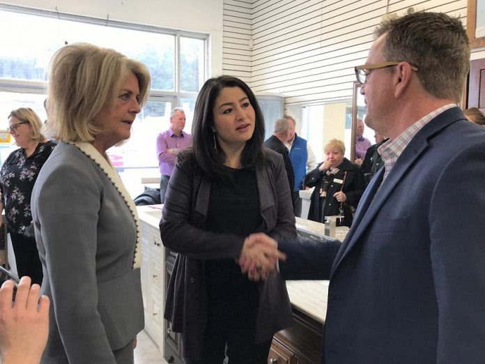 Jeff Day (right) is resigning as executive director of Community Futures Peterborough, effective January 12, 2018. At a December 8th Eastern Ontario Development Program announcement, Day shakes hands with Peterborough-Kawartha MP Maryam Monsef as Wendy Curtis, Executive Director of Northumberland Community Futures Development Corporation, looks on. (Photo: Office of Maryam Monsef)