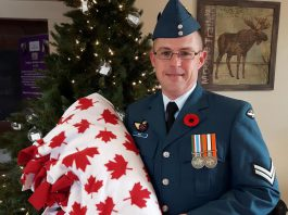 """Corporal Roy receiving his soldier blanket in November 2017 from Cuddles for Cancer, which is hosting a """"True Meaning of Christmas"""" event on Saturday, December 9th at the Cuddles Drop In location at 15 Queen Street in Lakefield. The day will begin with packing 17 boxes for Canadian soldiers who are serving overseas in Iraq, Romania, Kuwait, Ukraine, and Latvia. (Photo: Cuddles for Cancer)"""