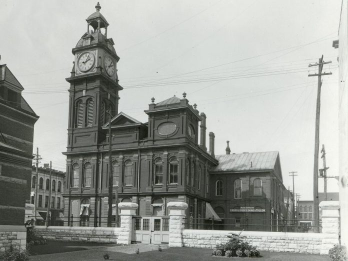 "The Market Hall was provincially designated as a heritage building in 1977. It is one of only a few 19th-century Ontario market buildings still in existence. The sign in the background reads ""Alex Gordon - Cash for Hides, Skins & Tallow""."