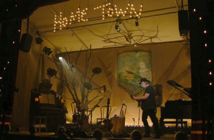 """Neil Young performing his """"Home Town"""" concert at Omemee's Coronation Hall on Friday, December 1st. (Live stream screen capture)"""