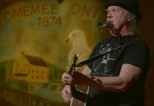 """Neil Young performing at Coronation Hall in Omemee, Ontario, on December 1, 2017 as part of his """"Home Town"""" concert that was live-streamed in Canada and around the world."""