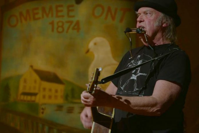 "Neil Young performing at Coronation Hall in Omemee, Ontario, on December 1, 2017 as part of his ""Home Town"" concert that was live-streamed in Canada and around the world."